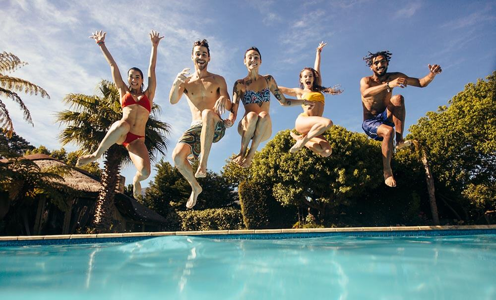 Young People Jumping Into Pool